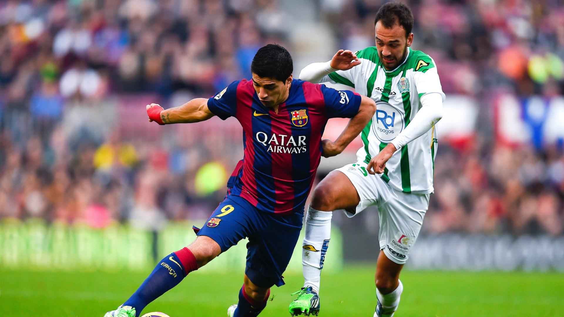 Deivid Rodríguez, junto a Luis Suárez en un partido de la temporada 2014/2015 en el Camp Nou